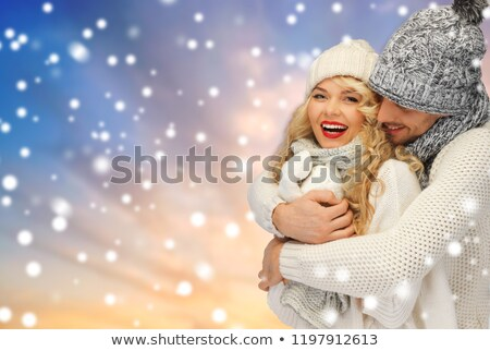 Foto stock: Smiling Couple In Sweaters Over Snow Background