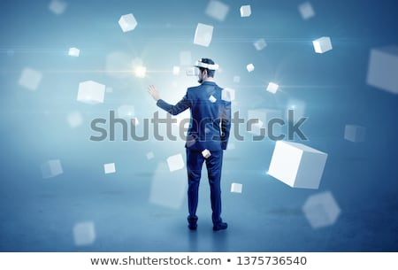 Businessman with vr goggle and falling cubes Stock photo © ra2studio