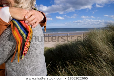 Low Section Of Couple Hugging At Beach Stock photo © AndreyPopov