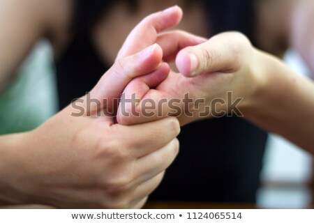 Woman Cracking Their Knuckles Stock photo © AndreyPopov