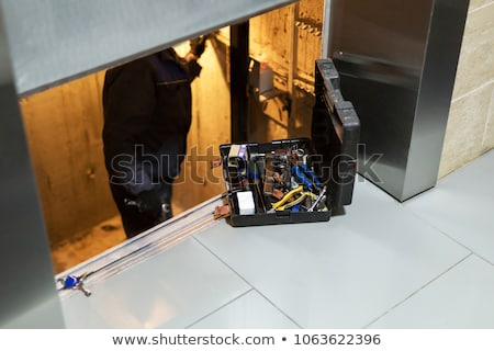 elevator repair man at work stock photo © lopolo