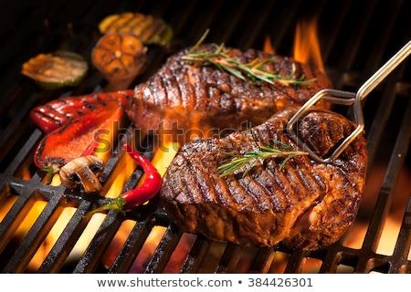 gegrild · rib · biefstuk · sappig · gietijzer - stockfoto © karandaev