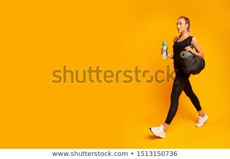 Młoda kobieta odzież sportowa wykonywania kobiet szczęśliwy Zdjęcia stock © HighwayStarz