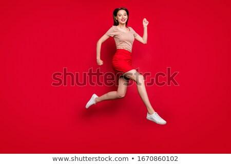 Gelukkig glimlachend meisje Rood shirt rok Stockfoto © dolgachov
