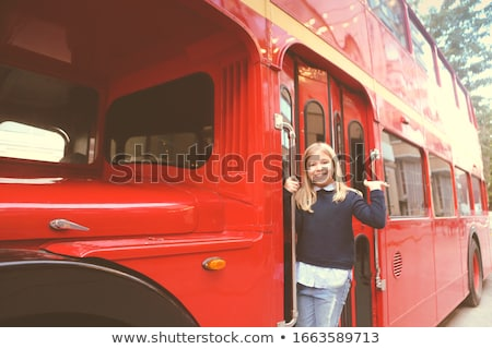 Preteen girl in entrance of red bus Stock photo © dashapetrenko