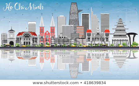 Ho Chi Minh Skyline with Gray Buildings, Blue Sky and Reflection Stock photo © ShustrikS