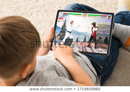 Kid Watching Live Game Streaming Session Stock photo © AndreyPopov
