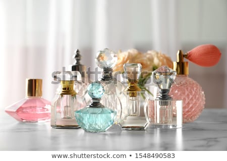 Fragrance bottle as vintage perfume product on background of peony flowers, parfum ad and beauty bra Stock photo © Anneleven