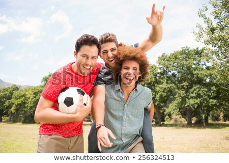 friends playing football posing together stock photo ...