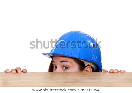 craftswoman hiding behind a table Stock photo © photography33