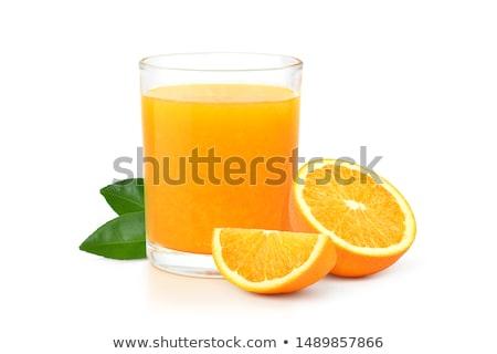 Stok fotoğraf: Orange Juice Pouring Into Glass Isolated On White