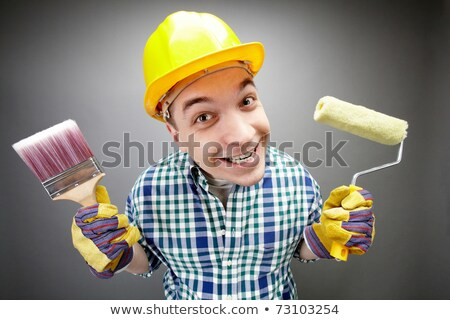 Happy painter with roller brush Stock photo © photography33