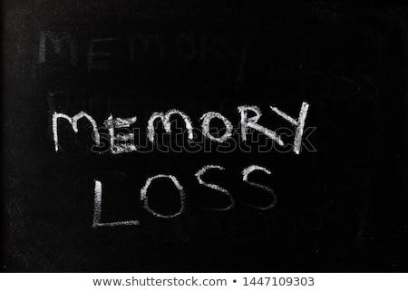 Education - word written on a smudged blackboard Stock photo © bbbar