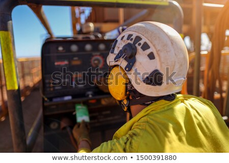 Worker on construction site wearing ear muffs Stock photo © photography33