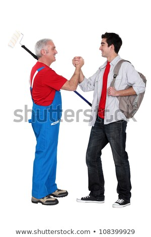 A mature painter shaking hand with his trainee. Stock photo © photography33