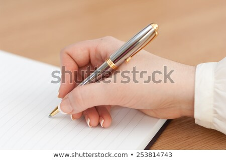Close-up shot of a woman pointing her pen Stock photo © photography33