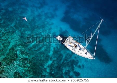 yacht and blue water ocean stock photo © zhukow