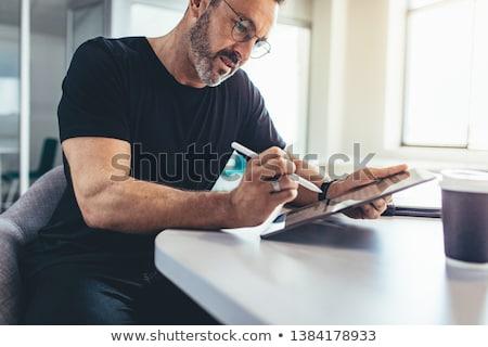 Tablet pikap iğnesi beyaz iş ışık boya Stok fotoğraf © kyolshin