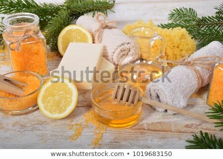 orange bath salt in wooden bowl stock photo © jirkaejc