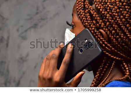 Foto stock: Young Woman Makes An Emergency Call