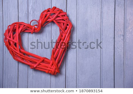 Wicker heart ornament with red cut out Stock photo © wavebreak_media
