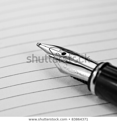 businessman writing with ink pen stock photo © andreypopov