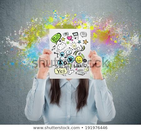 Woman hiding her face behind sign with online services. Online m Stock photo © hasloo