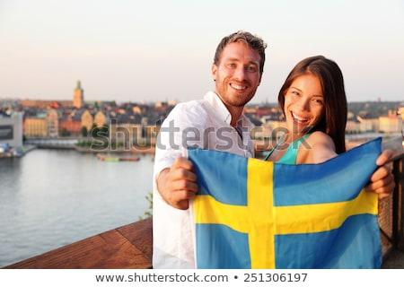 Sweden flag. Man holding banner with Swedish Flag. Stock photo © stevanovicigor