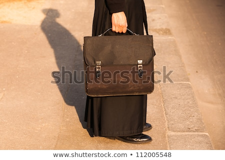 The detail of the priest on the street in Paris, France Stock photo © CaptureLight