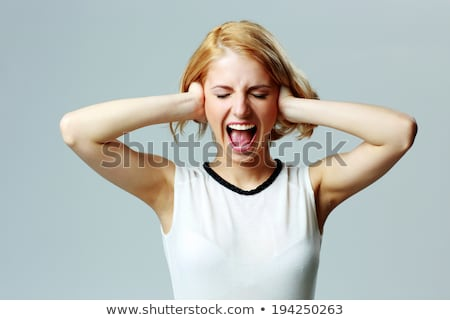 Woman open eyes covering ears Stock photo © ichiosea