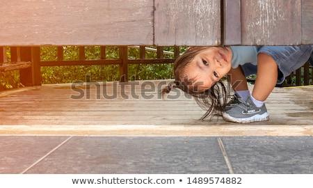 Gülen bayan beyaz gizleme Stok fotoğraf © Novic