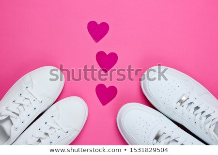 White sneakers with heart on white Stock photo © anmalkov