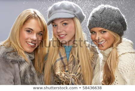 Three Fashionable Teenage Girls Wearing Cap And Knitwear In Stud Stock photo © monkey_business