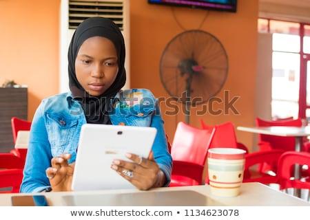 girl in internet cafe Stock photo © ssuaphoto