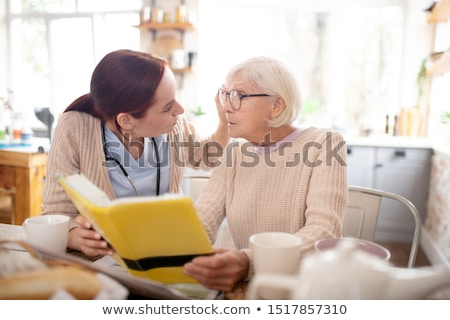 Stockfoto: Elderly Woman With Book