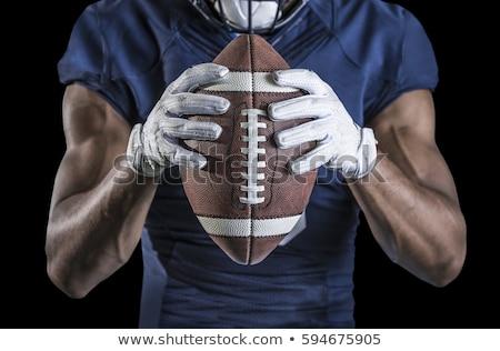 Football player in blue jersey holding ball Stock photo © wavebreak_media