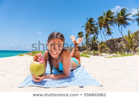 happy young woman lying in bikini swimsuit stock photo © dolgachov