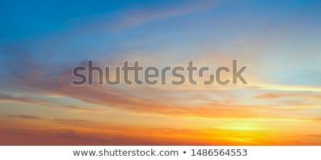 Gentle Sundown Sky with Sun and  Colorful Clouds Stock photo © Taiga