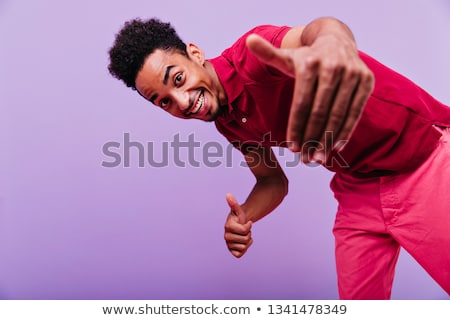 Stock photo: Boy in Red and Black T-Shirt Smiling at Camera