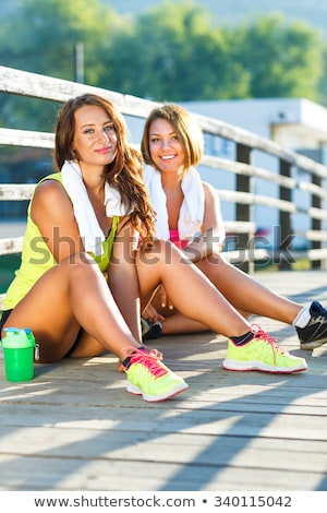 two girls have a rest after exercising outdoors stock photo © vlad_star