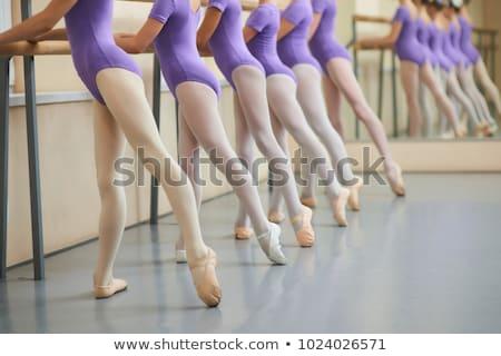 Ballerina stretching leg in ballet class Stock photo © deandrobot