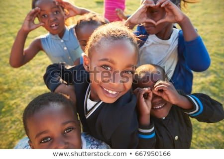 Black kid in field Stock photo © zurijeta