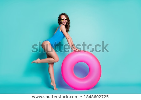Side view of a beautiful girl in blue swimsuit posing Stock photo © deandrobot