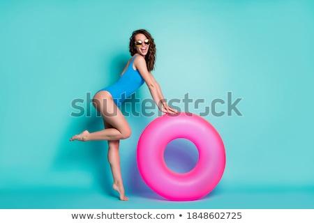 oldalnézet · gyönyörű · lány · kék · fürdőruha · pózol · gyönyörű - stock fotó © deandrobot