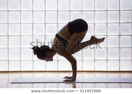 Yoga Crow Pose in wooden floor gym Stock photo © lunamarina