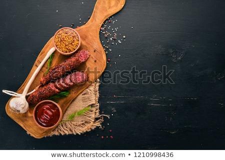 Fumado páprica salsicha carne de porco comida fundo branco Foto stock © Digifoodstock