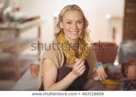 Femminile pittura ciotola ceramica workshop telefono Foto d'archivio © wavebreak_media