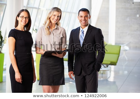 Stock photo: A portrait of three business people