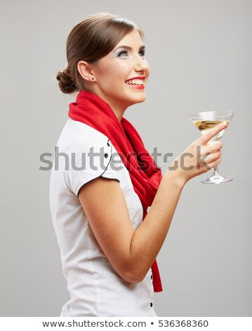 portrait of woman holding cocktail drink in hand on white Stock photo © LightFieldStudios