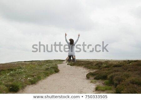 woman jumping on path in moors stock photo © is2